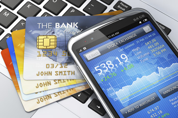 Image of keyboard, credit cards and cell phone