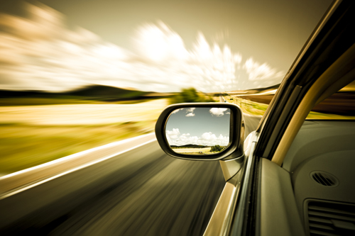 Driver's view of the side mirror while car is moving.