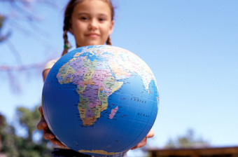 Climate Change - young girl holding out a globe.