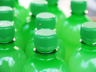 Greenwashing - Green bottles.