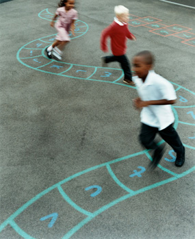 Healthy Communities - children playing in a school yard.