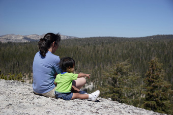 Natural Resource Protection - woman and child on a mountainside looking over a forest.