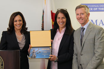 AG Kamala Harris presents the Smart on Crime Award to Five Keys Charter School's Sunny Schwartz and Steve Good