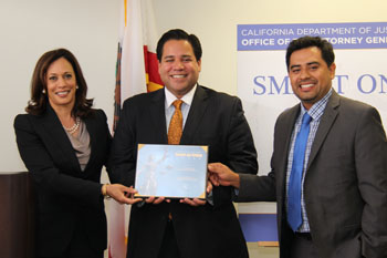 Ruben Gonzalez and Luis Barrera Castañón accept a Smart on Crime Award on behalf of the LA Area Chamber of Commerce.